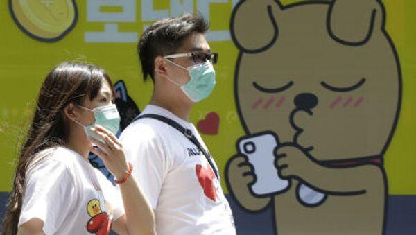 Người dân Seoul trên đường phố. - Sputnik Việt Nam