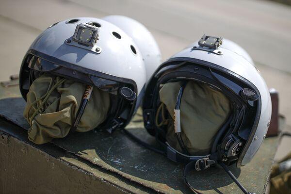 Mũ bay của các nữ học viên Trường Hàng không Quân sự Cao cấp Krasnodar tại sân bay Kushchevskaya ở Khu vực Krasnodar - Sputnik Việt Nam