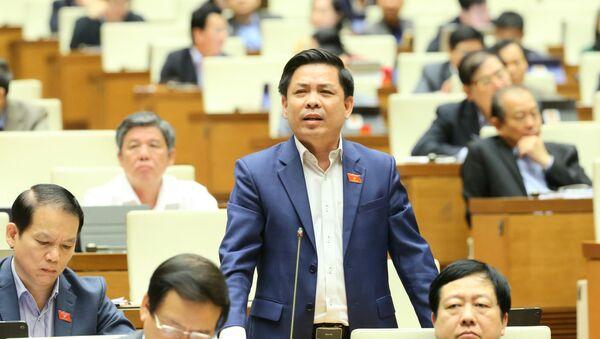 Bộ trưởng Bộ Giao thông vận tải Nguyễn Văn Thể phát biểu giải trình ý kiến đại biểu Quốc hội nêu. - Sputnik Việt Nam