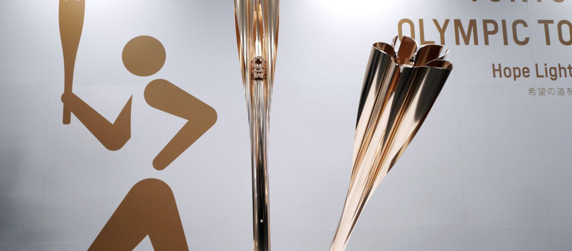 Trình diễn ngọn đuốc Thế vận hội Olympic và Paralympic 2020 ở Tokyo. - Sputnik Việt Nam, 1920, 06.07.2021