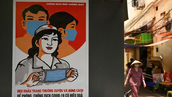 Áp phích chủ đề coronavirus trên phố Hà Nội. - Sputnik Việt Nam