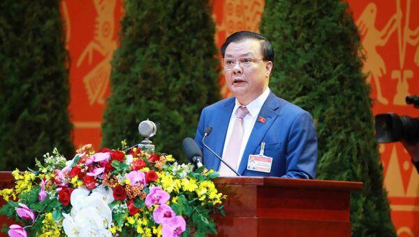 Đồng chí Đinh Tiến Dũng, Ủy viên Trung ương Đảng, Bí thư Ban cán sự đảng, Bộ trưởng Bộ Tài chính trình bày tham luận. - Sputnik Việt Nam