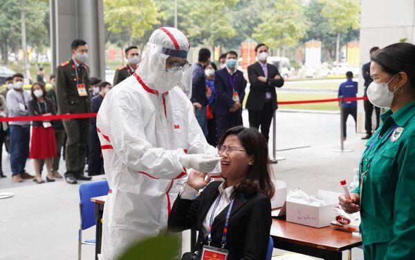 Thực hiện xét nghiệm Covid-19 lần 3 cho tất cả các phóng viên phục vụ Đại hội Đảng XIII - Sputnik Việt Nam