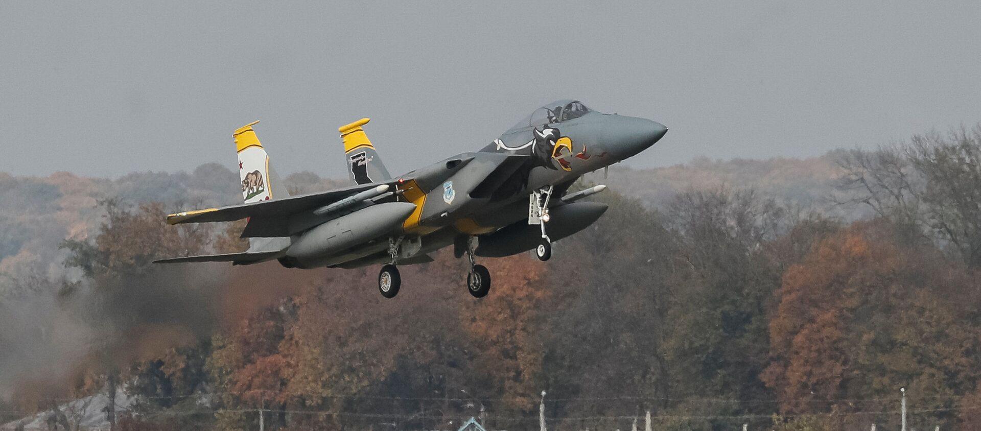 Máy bay chiến đấu F-15 của Không quân Hoa Kỳ tham gia cuộc tập trận Clear Sky-2018 ở Ukraina - Sputnik Việt Nam, 1920, 11.02.2021