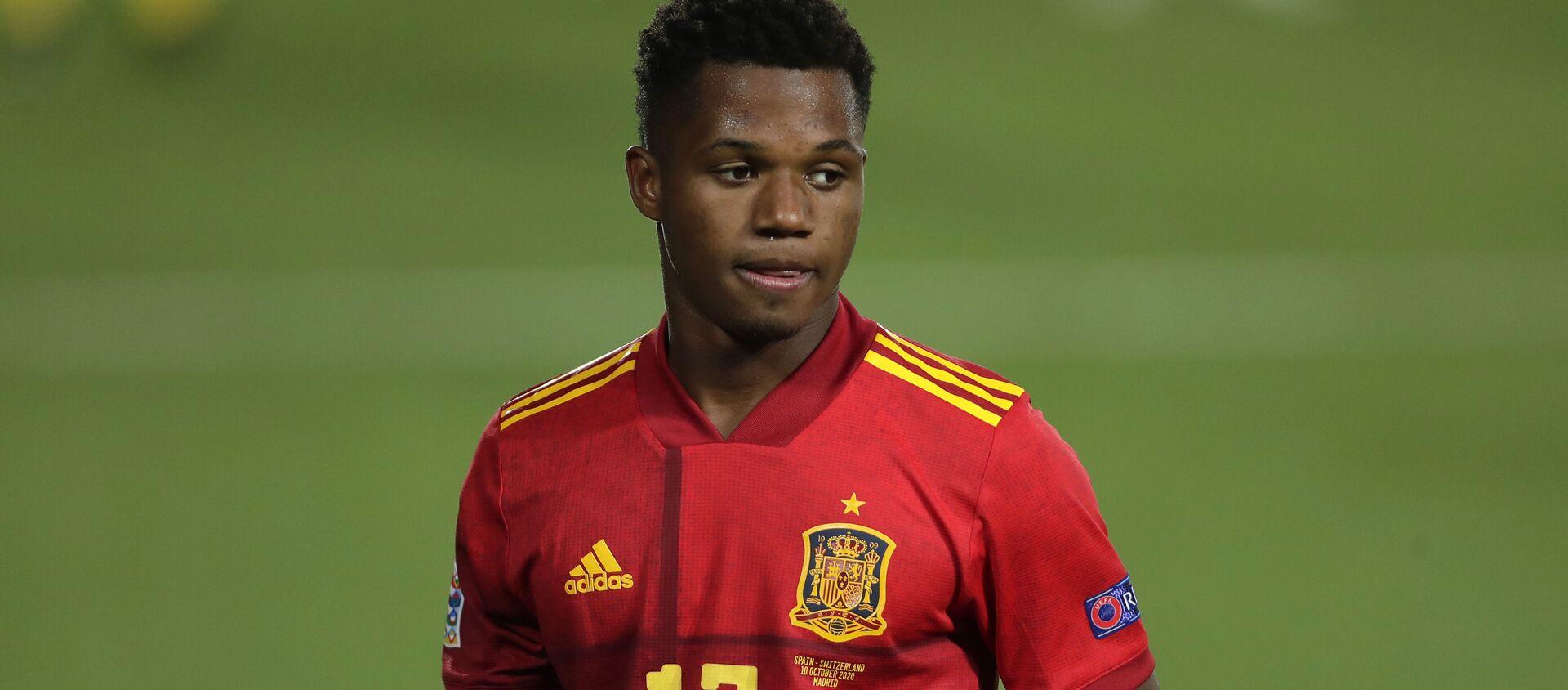 Cầu thủ bóng đá Tây Ban Nha Ansu Fati trong trận đấu tranh giải UEFA Nations League giữa đội tuyển quốc gia Tây Ban Nha và Thụy Sĩ tại Madrid, Tây Ban Nha. - Sputnik Việt Nam, 1920, 14.02.2021