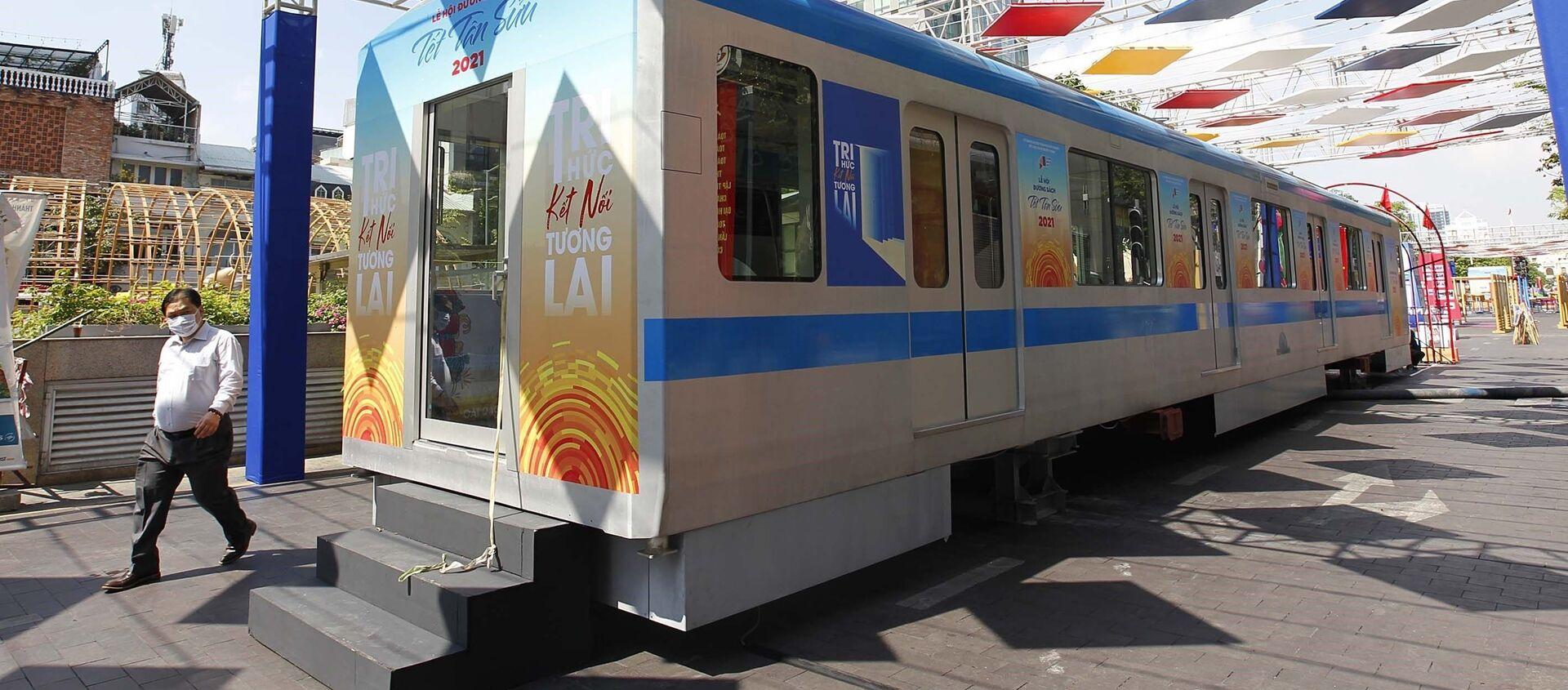 Triển lãm mô hình toa tàu của tuyến đường sắt đô thị Thành phố Hồ Chí Minh – tuyến Metro số 1 Bến Thành - Suối Tiên trên tuyến đường Nguyễn Huệ, Quận 1. - Sputnik Việt Nam, 1920, 22.02.2021