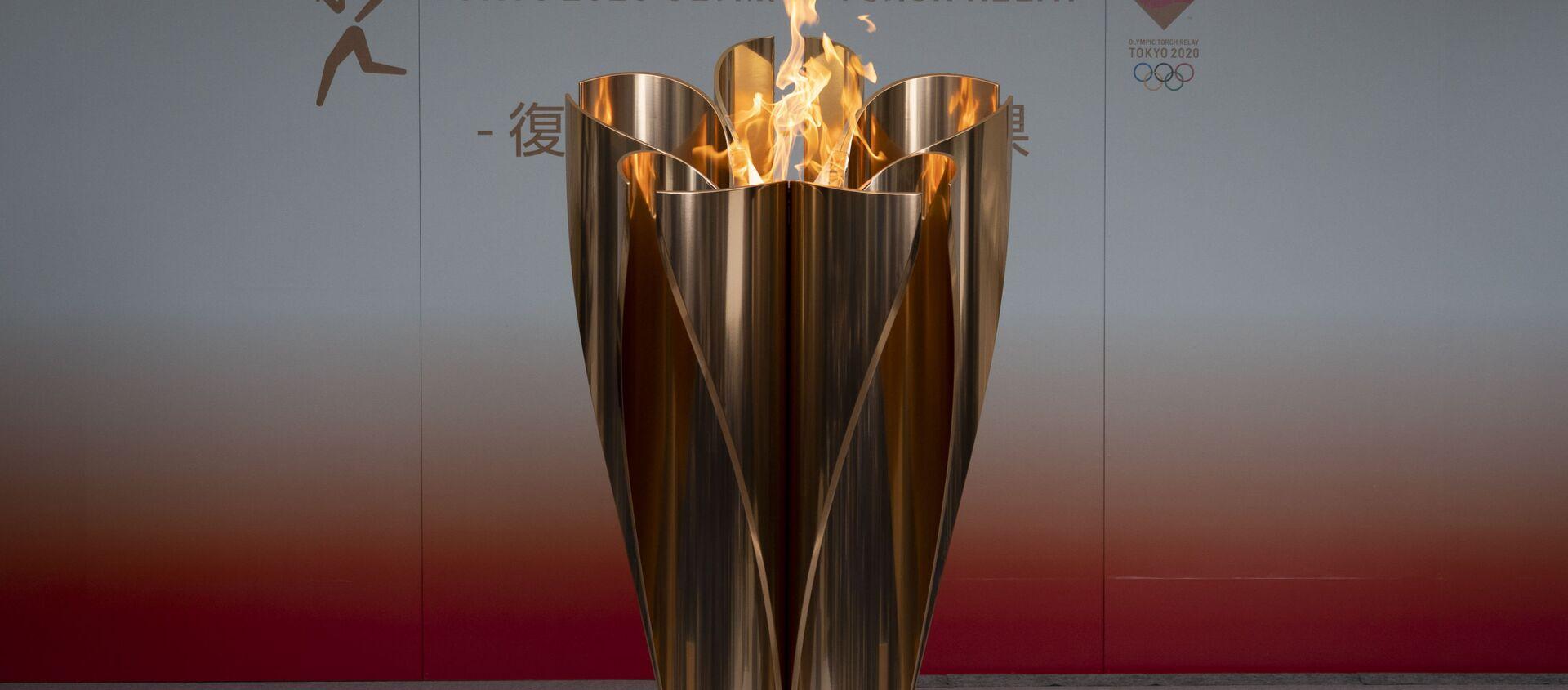 Ngọn lửa Olympic ở thành phố Fukushima, Nhật Bản. - Sputnik Việt Nam, 1920, 26.03.2021