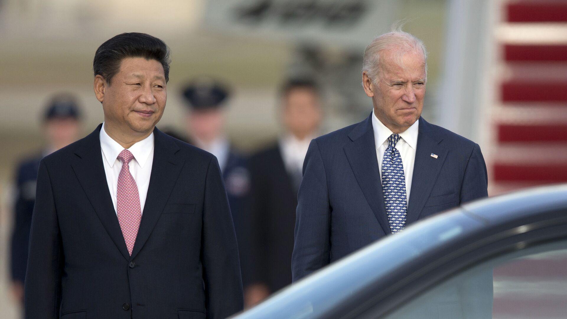 Chủ tịch nước Cộng hòa Nhân dân Trung Hoa Tập Cận Bình và Phó Tổng thống Hoa Kỳ Joe Biden tại Washington, năm 2015. - Sputnik Việt Nam, 1920, 21.09.2021