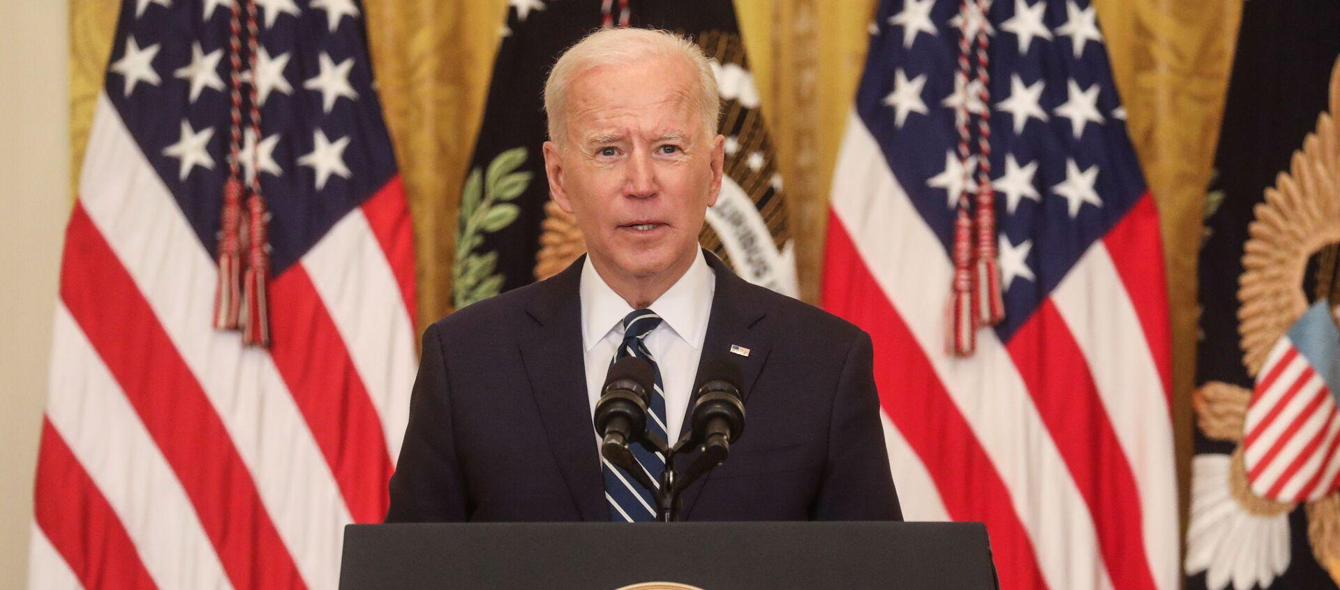 Tổng thống Mỹ Joe Biden phát biểu tại Nhà Trắng trong cuộc họp báo đầu tiên trên cương vị Nguyên thủ quốc gia - Sputnik Việt Nam, 1920, 26.03.2021