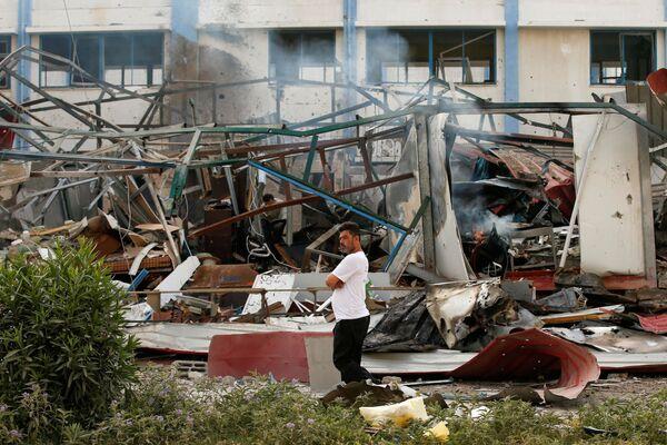 Người Palestine tại nơi bị Israel không kích vào Dải Gaza - Sputnik Việt Nam