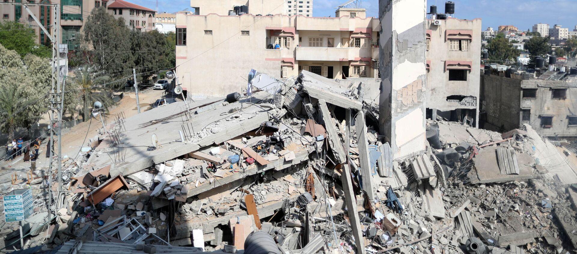 Những tòa nhà bị phá hủy ở Dải Gaza vì hứng đòn không kích của Israel. - Sputnik Việt Nam, 1920, 19.05.2021