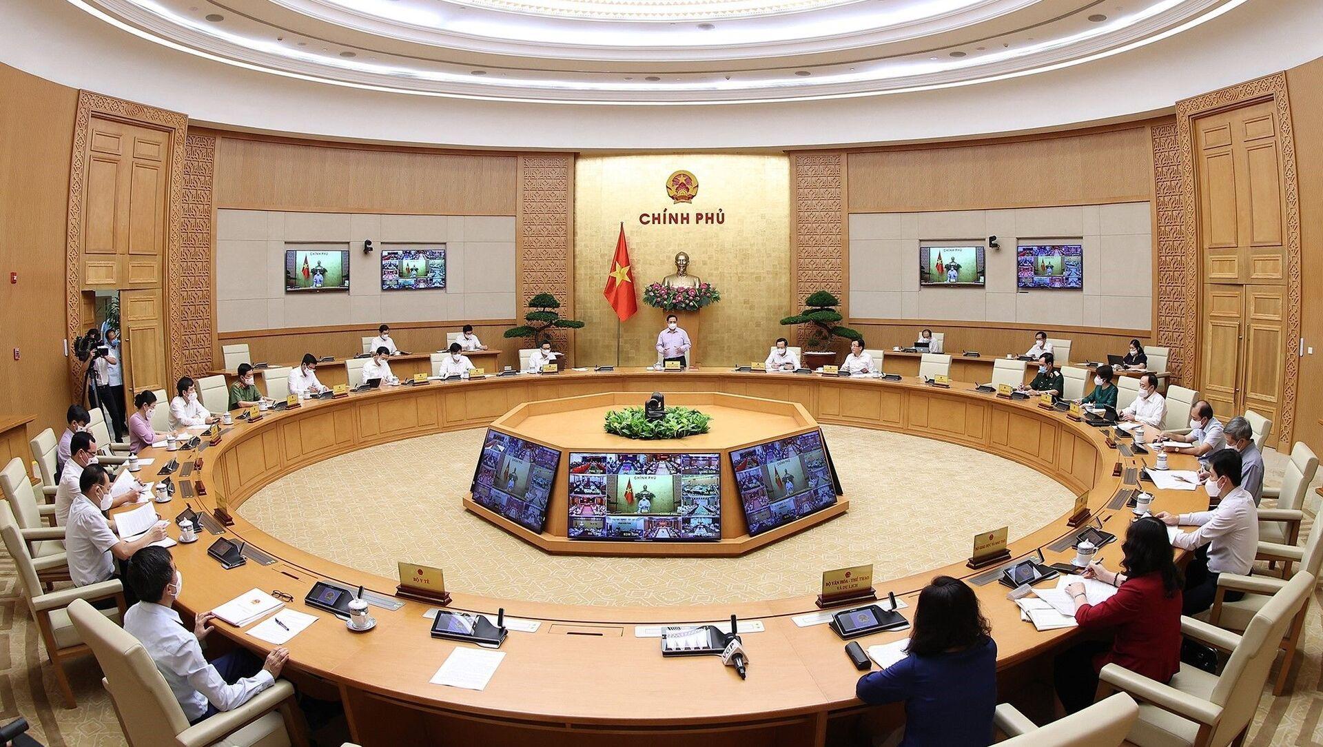 Quang cảnh Hội nghị trực tuyến toàn quốc về phòng, chống dịch COVID-19, tại điểm cầu trụ sở Chính phủ. - Sputnik Việt Nam, 1920, 31.05.2021
