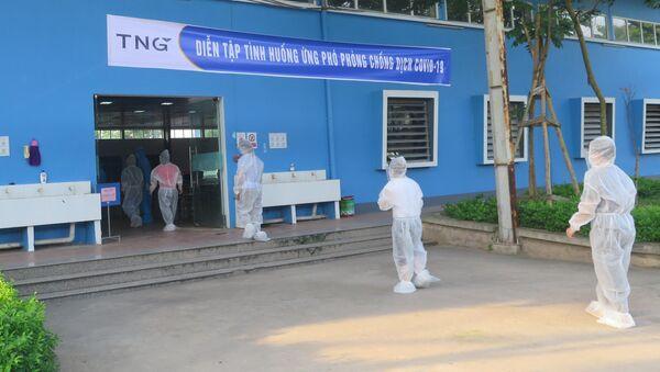 Tình huống phát hiện ca nghi nhiễm COVID-19 được phát hiện trong công ty có hàng trăm công nhân. - Sputnik Việt Nam