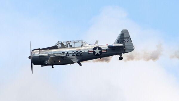 Máy bay phản lực T-6 Texan tại triển lãm hàng không Seafair, trong cuộc đua thủy phi cơ Chevrolet Cup trên hồ Washington, Seattle, 2008. - Sputnik Việt Nam
