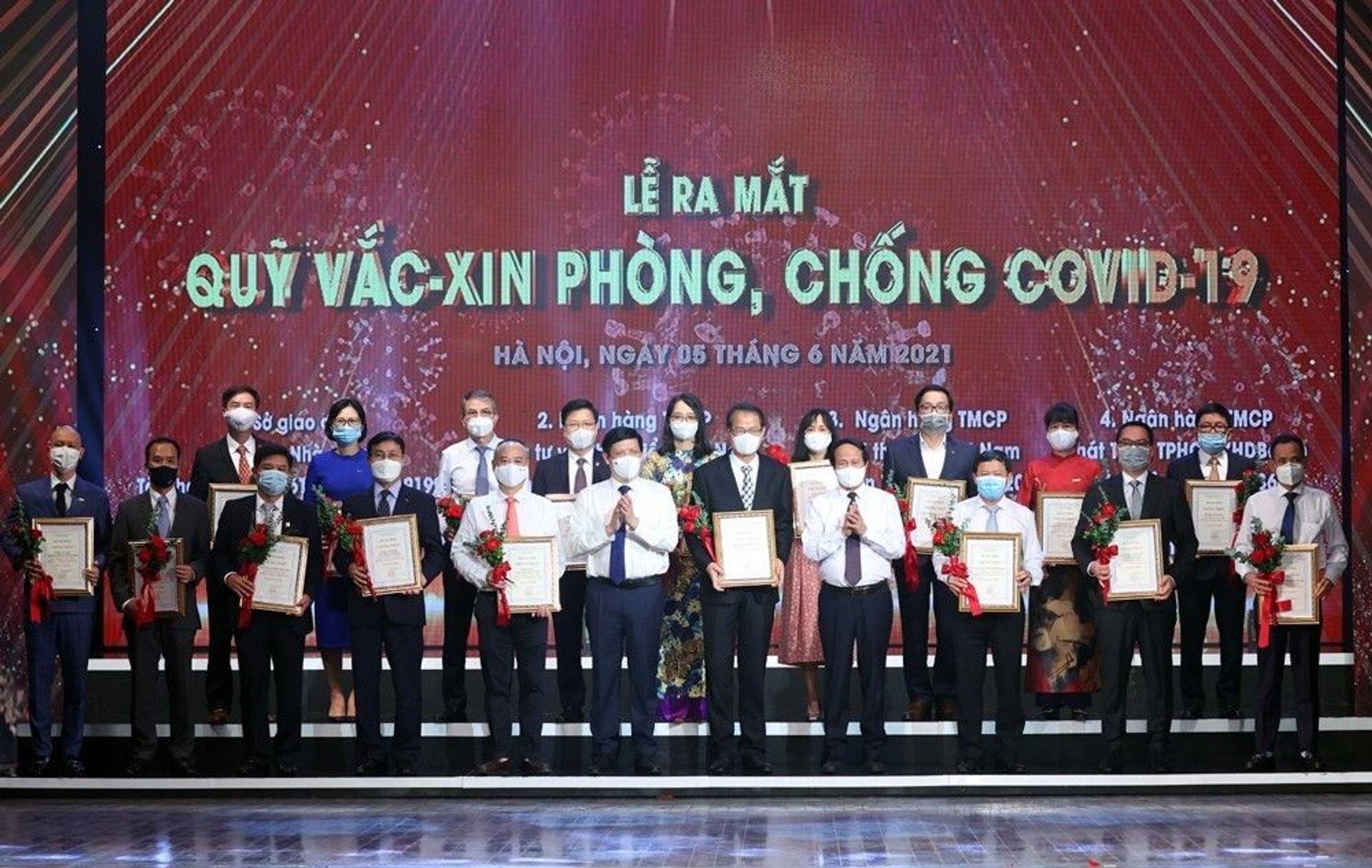 Lễ ra mắt Quỹ vắc-xin phòng, chống Covid-19: Hàng nghìn tỷ đồng ủng hộ đến từ các doanh nghiệp, tập đoàn lớn  - Sputnik Việt Nam, 1920, 06.06.2021