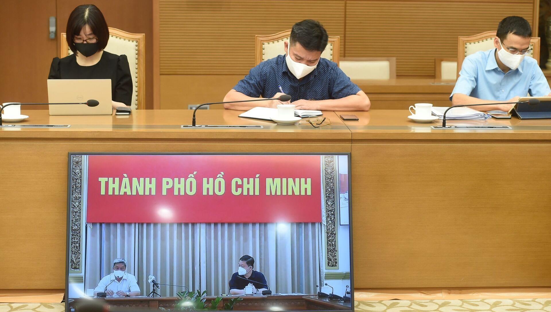 Điểm cầu trực tuyến từ Thành phố Hồ Chí Minh tại cuộc họp với Phó Thủ tướng Vũ Đức Đam - Sputnik Việt Nam, 1920, 18.06.2021