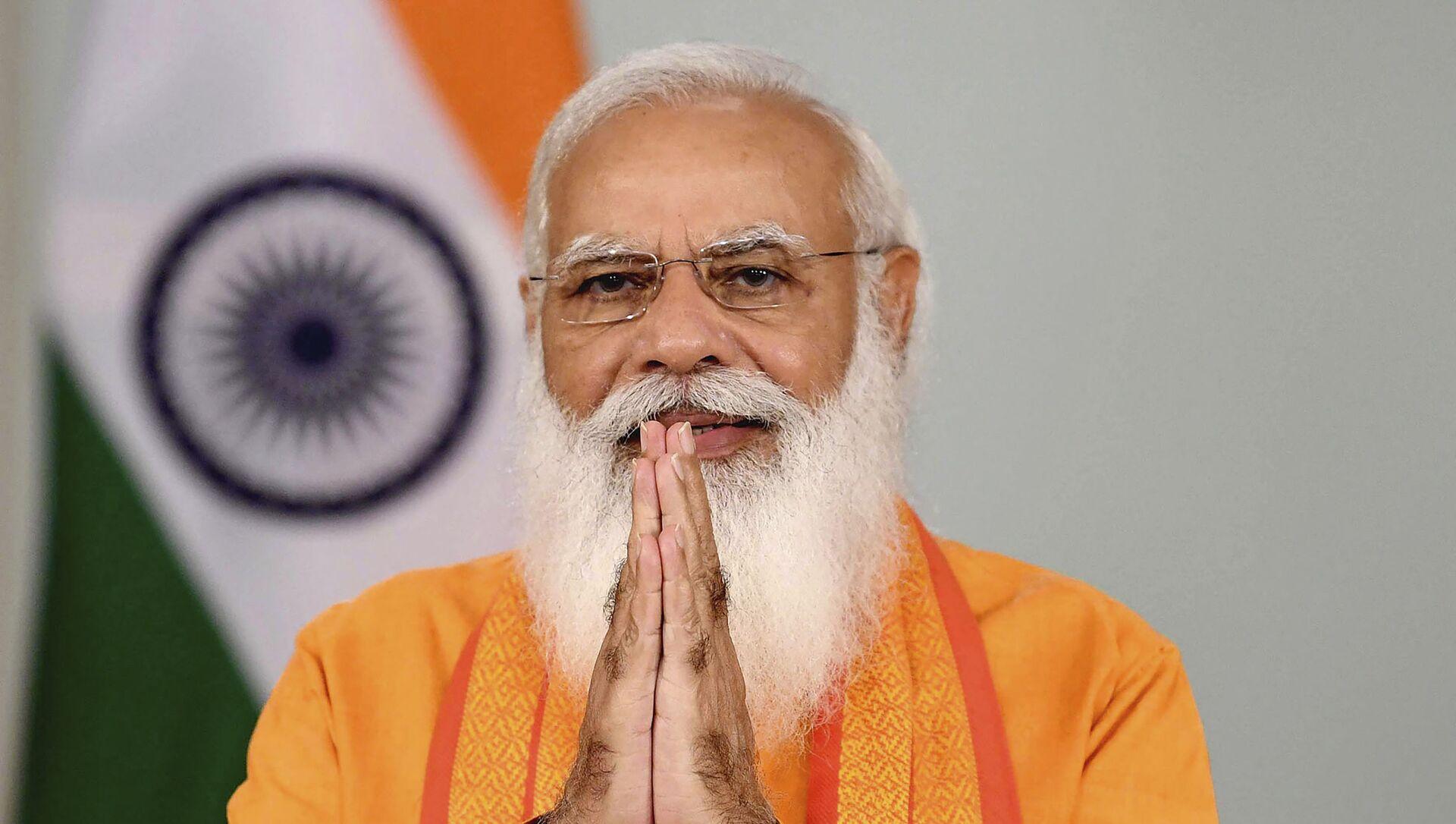 Thủ tướng Ấn Độ Narendra Modi phát biểu tại hội nghị truyền hình trong khuôn khổ chương trình Ngày Quốc tế Yoga ở New Delhi - Sputnik Việt Nam, 1920, 18.09.2021