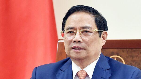 Thủ tướng Phạm Minh Chính điện đàm với Thủ tướng Đức Angela Merkel. - Sputnik Việt Nam