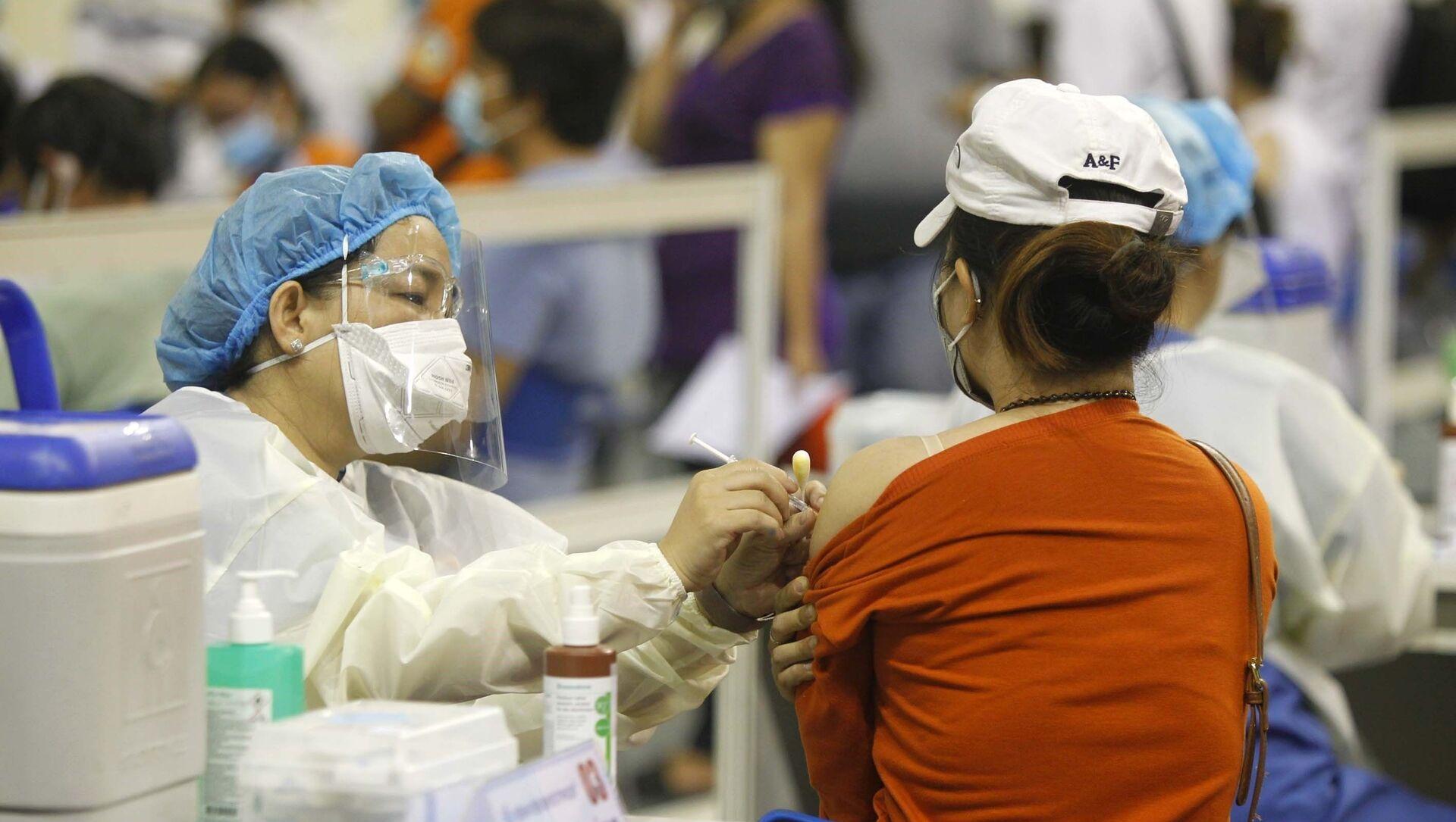 Người lao động Thành phố Hồ Chí Minh được tiêm vaccine phòng COVID-19. - Sputnik Việt Nam, 1920, 28.06.2021
