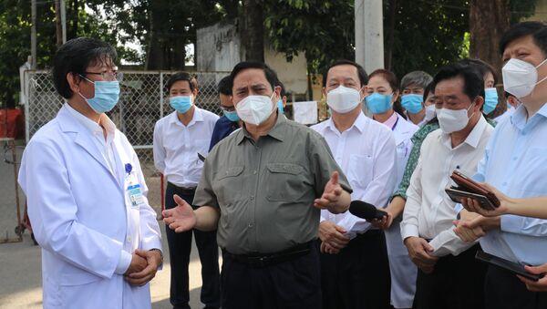 Thủ tướng Phạm Minh Chính làm việc với tỉnh Bình Dương về công tác phòng, chống dịch COVID-19 - Sputnik Việt Nam