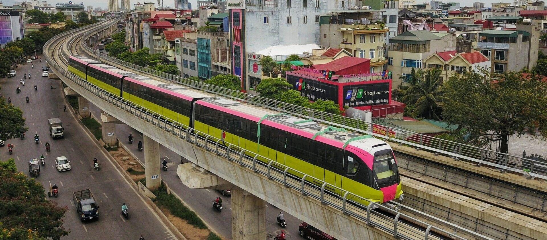Đoàn tàu chạy qua tuyến đường Nhổn - Ga Hà Nội (đoạn trên cao dài 8,5km từ Nhổn đến Đại học Giao thông vận tải). - Sputnik Việt Nam, 1920, 01.07.2021