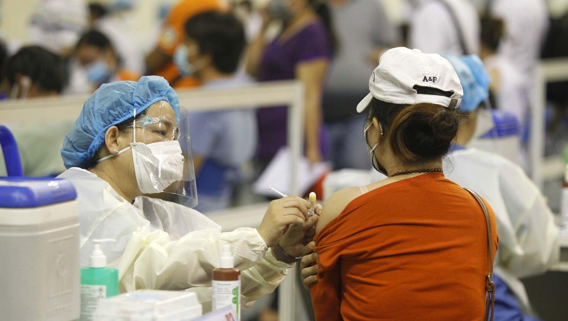 Người lao động Thành phố Hồ Chí Minh được tiêm vaccine phòng COVID-19. - Sputnik Việt Nam, 1920, 13.07.2021