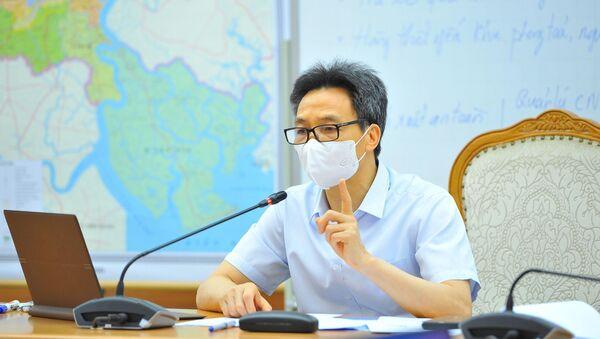 COVID-19: Phó Thủ tướng Vũ Đức Đam họp giao ban trực tuyến với TP. Hồ Chí Minh - Sputnik Việt Nam