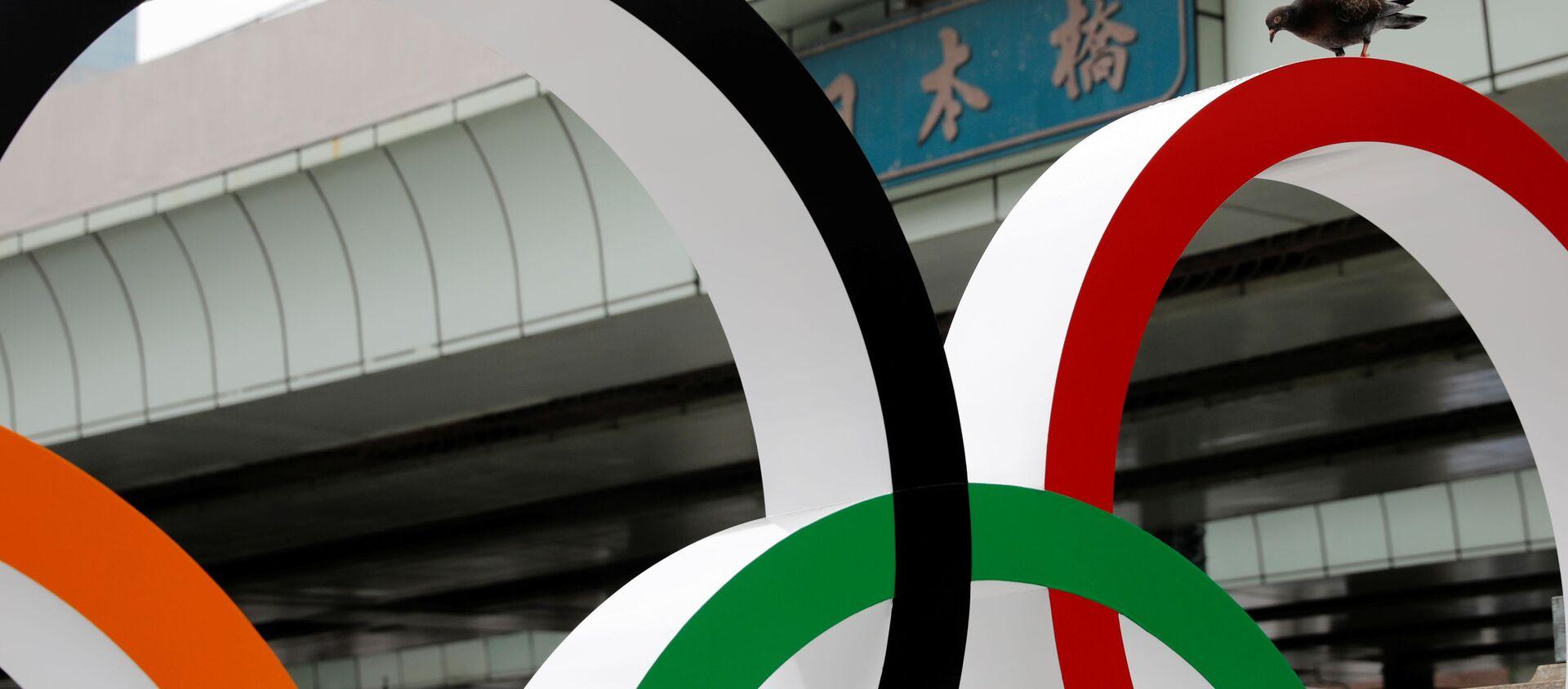 Chim bồ câu đậu trên các vòng tròn Olympic, Tokyo  - Sputnik Việt Nam, 1920, 14.07.2021