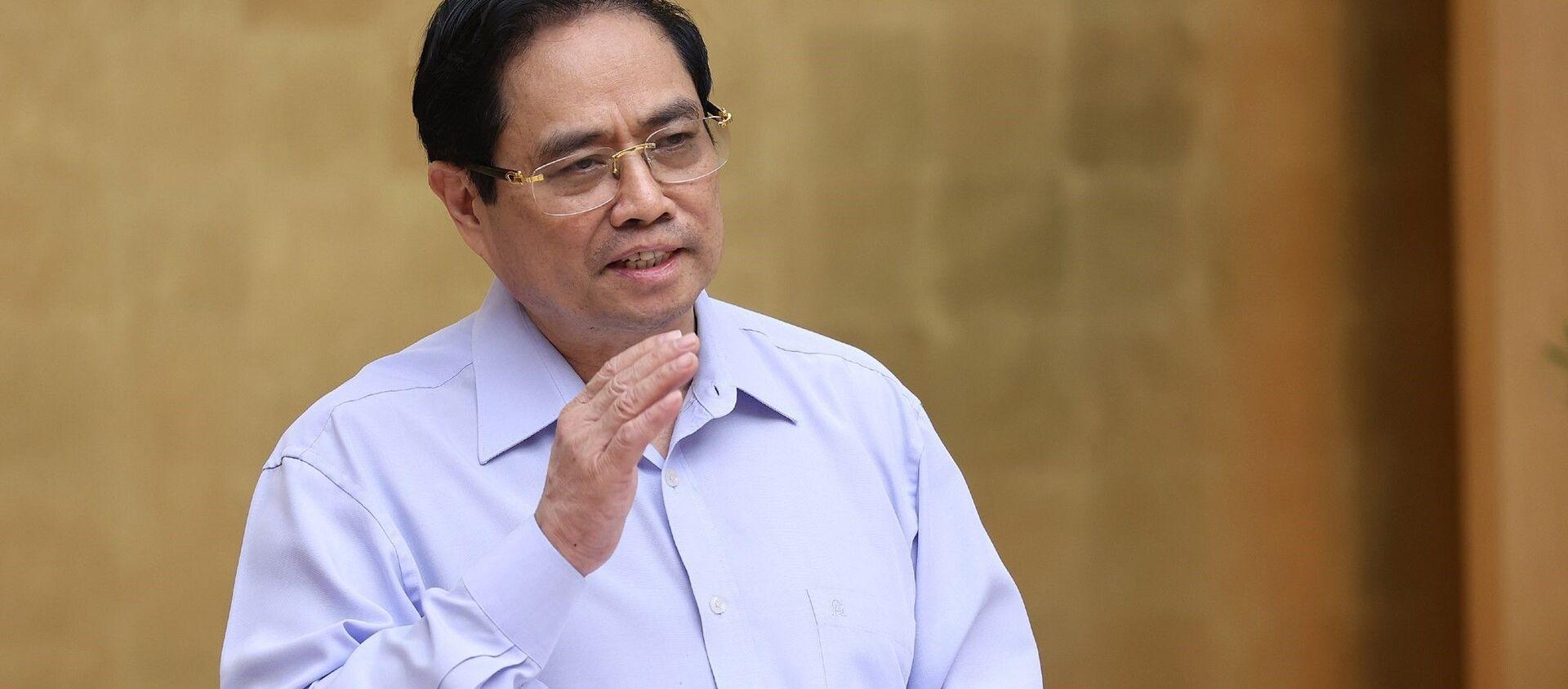 Thủ tướng Phạm Minh Chính chủ trì hội nghị trực tuyến với các tỉnh, thành phía Nam triển khai các biện pháp cấp bách phòng, chống dịch COVID-19 - Sputnik Việt Nam, 1920, 21.07.2021
