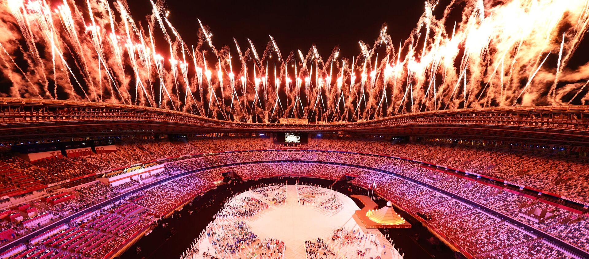 Bắn pháo hoa trên Sân vận động Olympic Quốc gia tại lễ khai mạc Thế vận hội Olympic mùa hè lần thứ XXXII ở Tokyo - Sputnik Việt Nam, 1920, 24.07.2021
