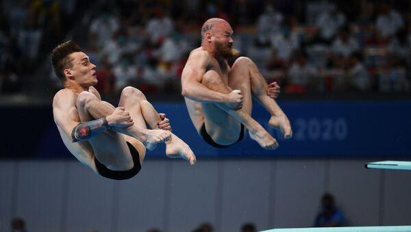 Các thợ lặn người Nga Evgeny Kuznetsov và Nikita Schleikher - Sputnik Việt Nam
