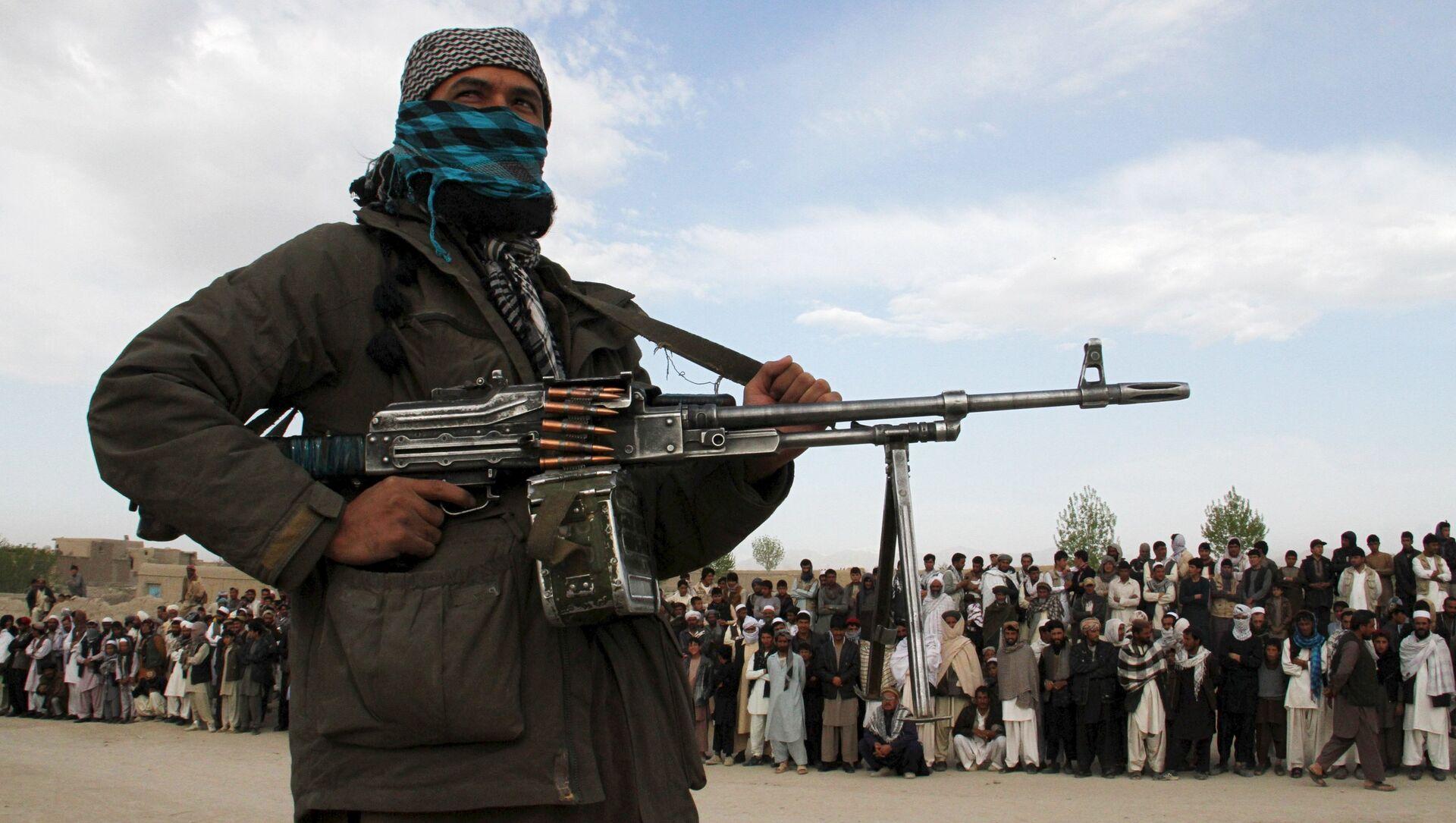 Một thành viên của quân nổi dậy Taliban - Sputnik Việt Nam, 1920, 04.08.2021