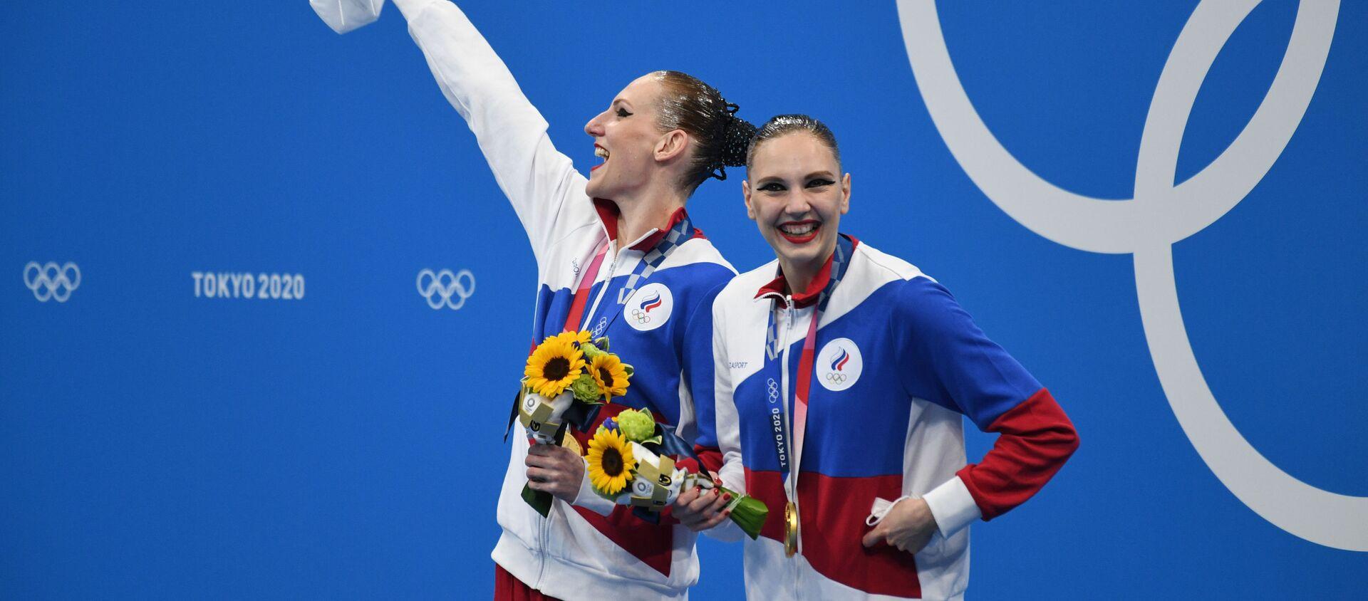 Nữ VĐV bơi nghệ thuật Svetlana Romashina và Sveltana Kolesnichenko giành huy chương vàng tại Olympic Tokyo - Sputnik Việt Nam, 1920, 07.08.2021