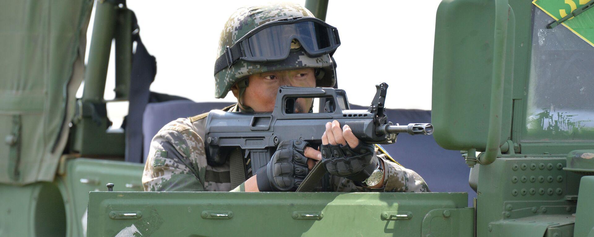 Một quân nhân của CHND Trung Hoa tham gia cuộc tập trận chung chống khủng bố Sứ mệnh Hòa bình 2018 của lực lượng vũ trang các quốc gia thành viên SCO tại khu huấn luyện Chebarkul - Sputnik Việt Nam, 1920, 10.08.2021
