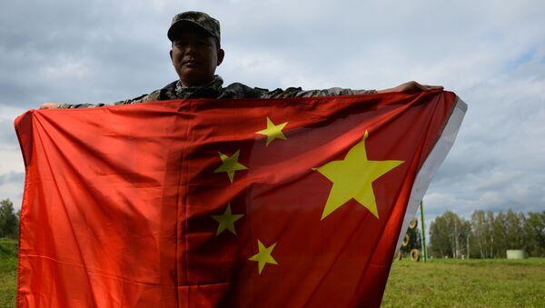 Một quân nhân của lực lượng vũ trang nước CHND Trung Hoa sau khi kết thúc chặng 1 Đổ bộ, hành quân của cuộc thi quốc tế Quân báo giỏi - Sputnik Việt Nam