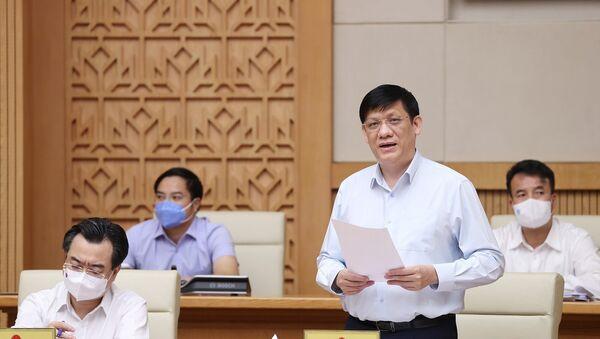 Bộ trưởng Bộ Y tế Nguyễn Thanh Long báo cáo kết quả phòng, chống dịch COVID-19. - Sputnik Việt Nam