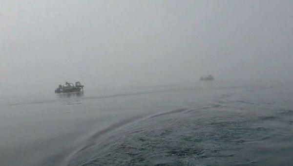 Công việc tìm kiếm tại địa điểm rơi máy bay trực thăng Mi-8 ở hồ Kuril - Sputnik Việt Nam