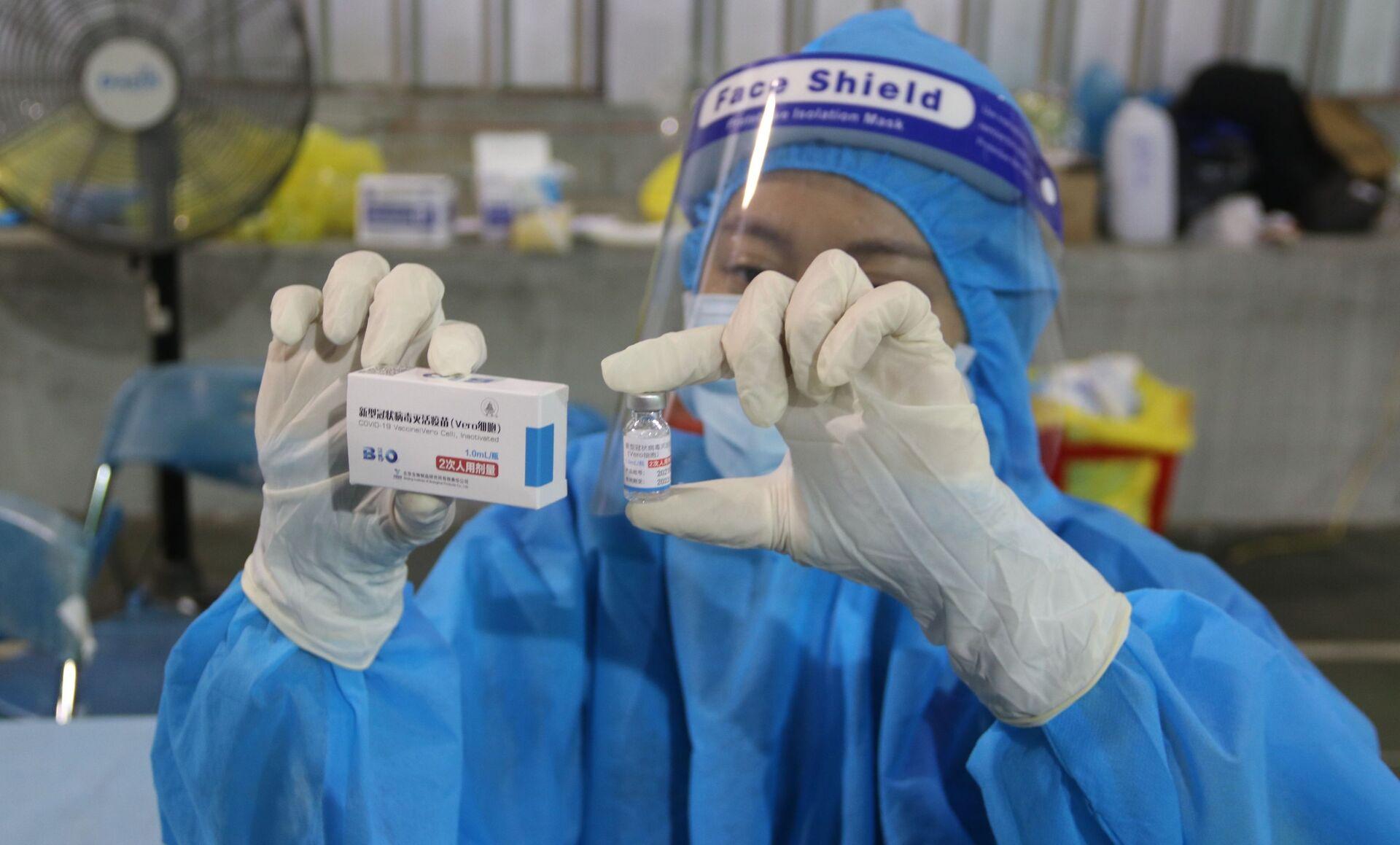 Vaccine Vero Cell của Sinopharm được sử dụng tiêm chủng tại điểm tiêm số 1 Huyền Trần Công Chúa (Quận 1). - Sputnik Việt Nam, 1920, 05.10.2021