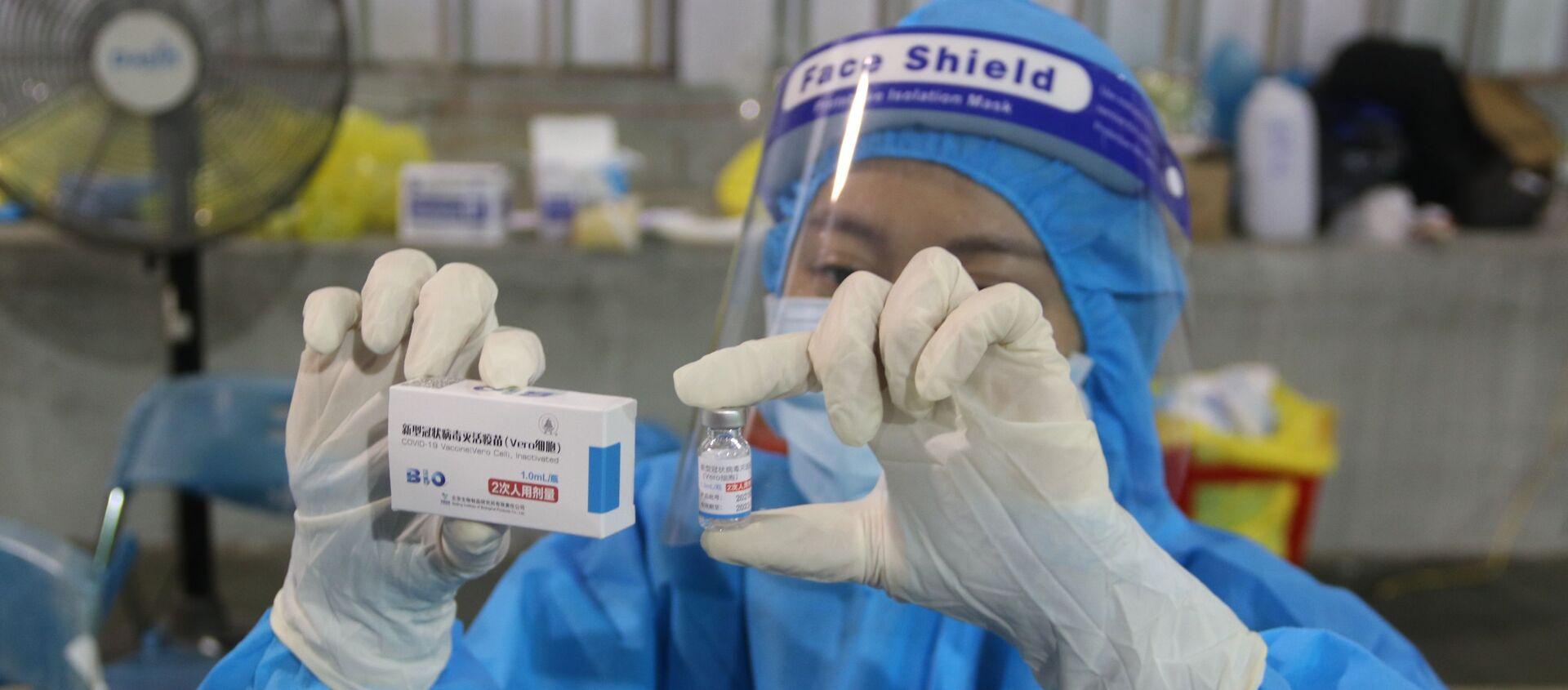 Vaccine Vero Cell của Sinopharm được sử dụng tiêm chủng tại điểm tiêm số 1 Huyền Trần Công Chúa (Quận 1). - Sputnik Việt Nam, 1920, 16.08.2021