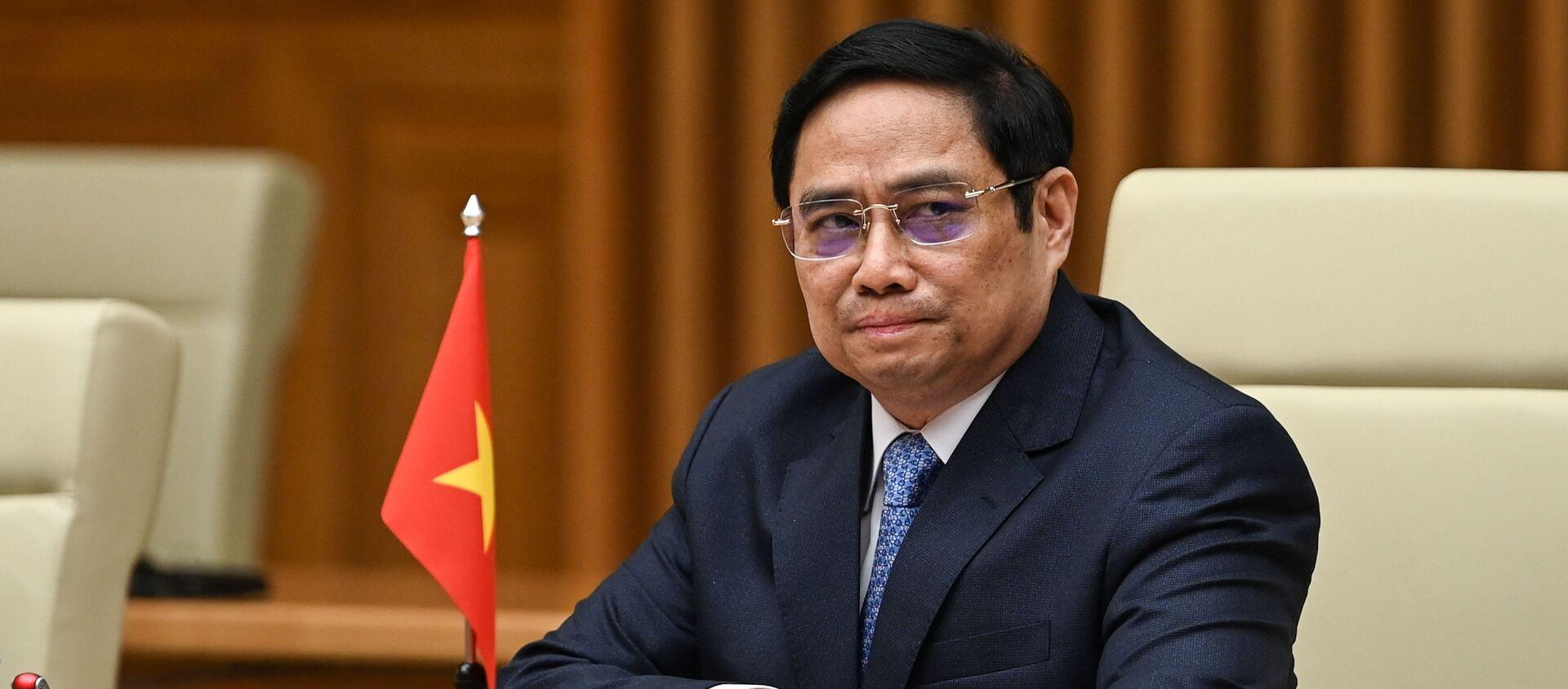 Thủ tướng Việt Nam Phạm Minh Chính tham dự cuộc họp với Phó Tổng thống Hoa Kỳ Kamala Harris tại Văn phòng Chính phủ ở Hà Nội ngày 25/8/2021. - Sputnik Việt Nam, 1920, 26.08.2021