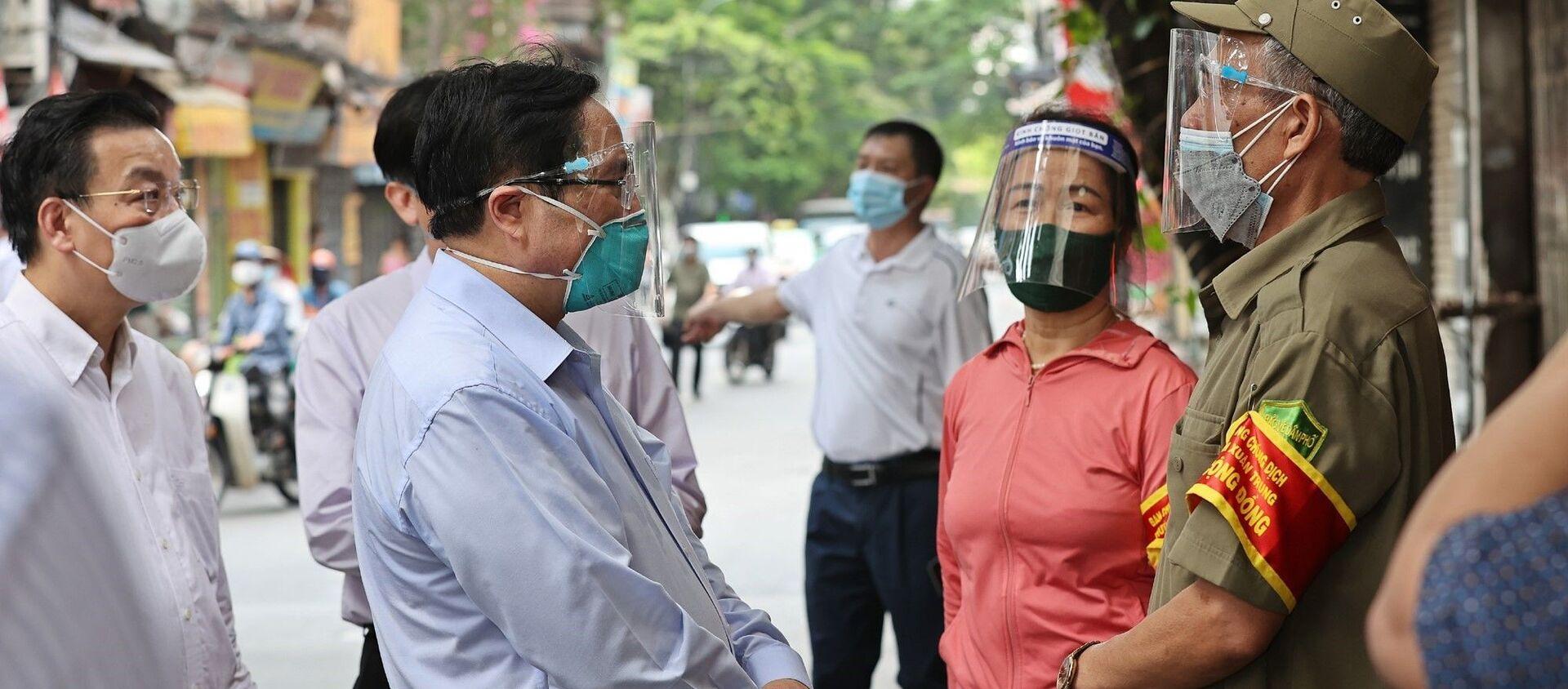 Thủ tướng Phạm Minh Chính kiểm tra đột xuất các điểm nóng về dịch bệnh COVID-19 tại Hà Nội - Sputnik Việt Nam, 1920, 01.09.2021