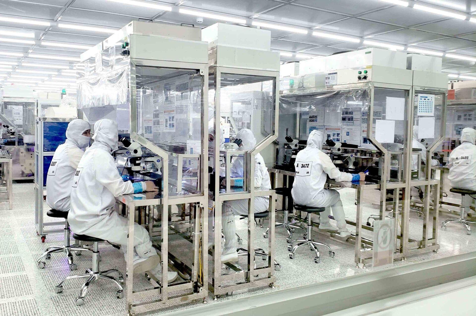Công ty Optrontec Vina khu công nghiệp Bá Thiện 2, Vĩnh Phúc là công ty 100% vốn Hàn Quốc. - Sputnik Việt Nam, 1920, 05.10.2021