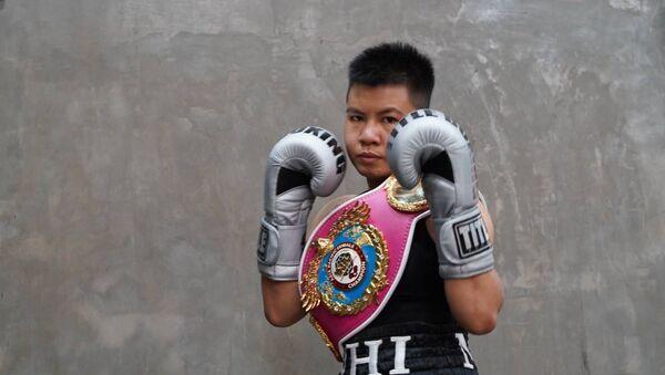 Nguyễn Thị Thu Nhi là nữ võ sĩ quyền anh Việt Nam đầu tiên tạo nên kỳ tích Boxing khi giành đai vô địch WBO Châu Á - Thái Bình Dương ở hạng cân nhẹ. - Sputnik Việt Nam