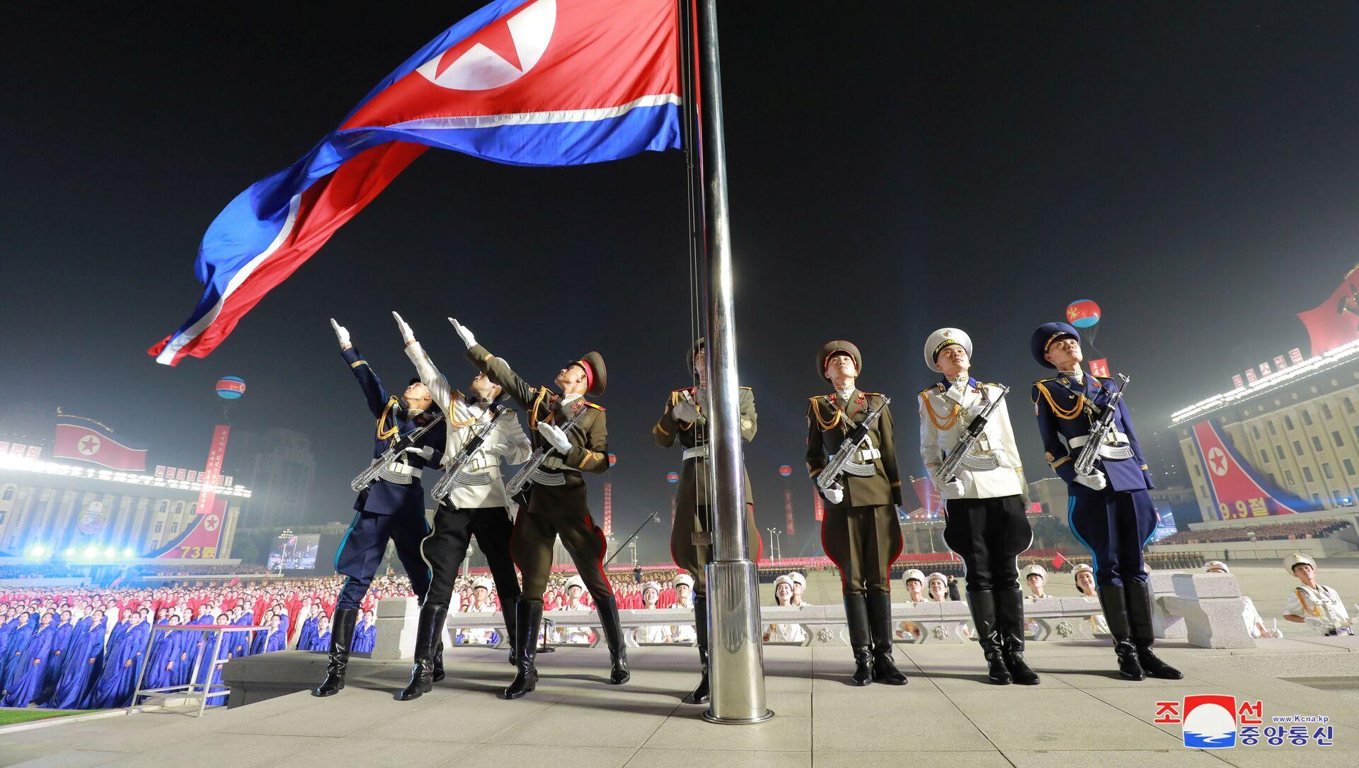 Сuộc duyệt binh của lực lượng dân quân và an ninh để  kỷ niệm 73 năm ngày thành lập Chính phủ nhân dân và Quốc khánh CHDCND Triều Tiên - Sputnik Việt Nam, 1920, 09.09.2021