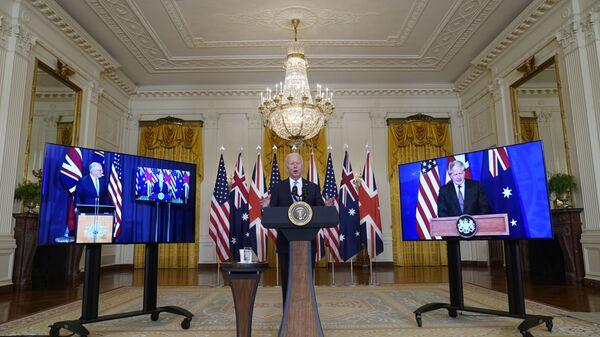 Tổng thống Joe Biden, Thủ tướng Úc Scott Morrison và Thủ tướng Anh Boris Johnson tại cuộc họp trực tuyến về sáng kiến an ninh quốc gia mới của Hoa Kỳ hợp tác với Úc và Vương quốc Anh - Sputnik Việt Nam