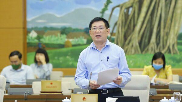 Bộ trưởng Bộ Tài chính Hồ Đức Phớc trình bày báo cáo. - Sputnik Việt Nam