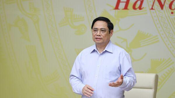 Thủ tướng Phạm Minh Chính chủ trì Hội nghị bàn giải pháp hỗ trợ doanh nghiệp trong bối cảnh dịch COVID-19 - Sputnik Việt Nam