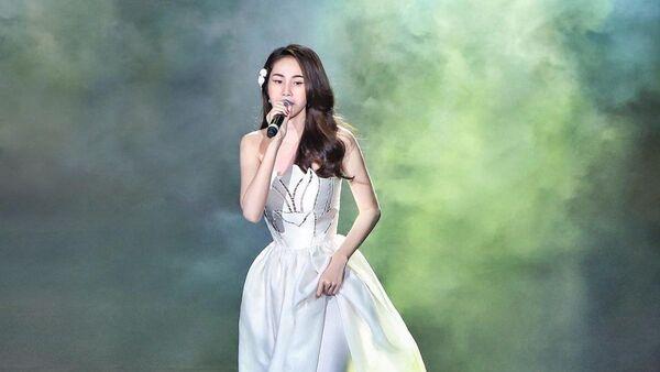 Вьетнамская певица Туи Тьен - Sputnik Việt Nam