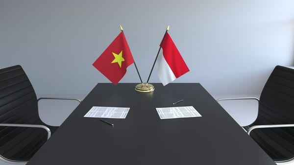 Флаги Вьетнама и Индонезии за столом переговоров - Sputnik Việt Nam