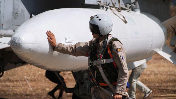 Phi công Nga trước giờ xuất kích tại căn cứ không quân Hmeymimở Syria - Sputnik Việt Nam